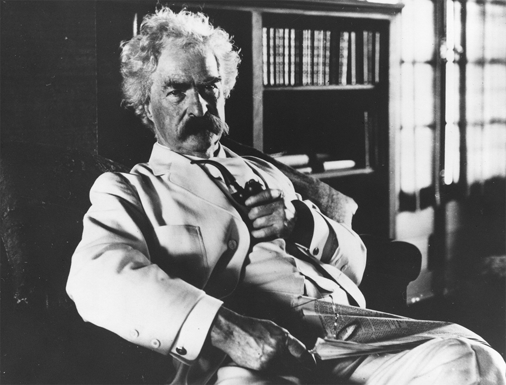 a picture of Twain taken in October 1908 in the library of his newly built house in Redding, Conn